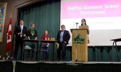 Presentation of awards to finalists at the 2016 Halifax Grammar School Invitational. L to R: top team Will Luton (Fredericton High School) & Jack Farrell (Halifax Grammar), finalists Madeleine Peet (Sacred Heart) & Hamish Wright (Fredericton High School), tournament director Caraid McGinity (Halifax Grammar).